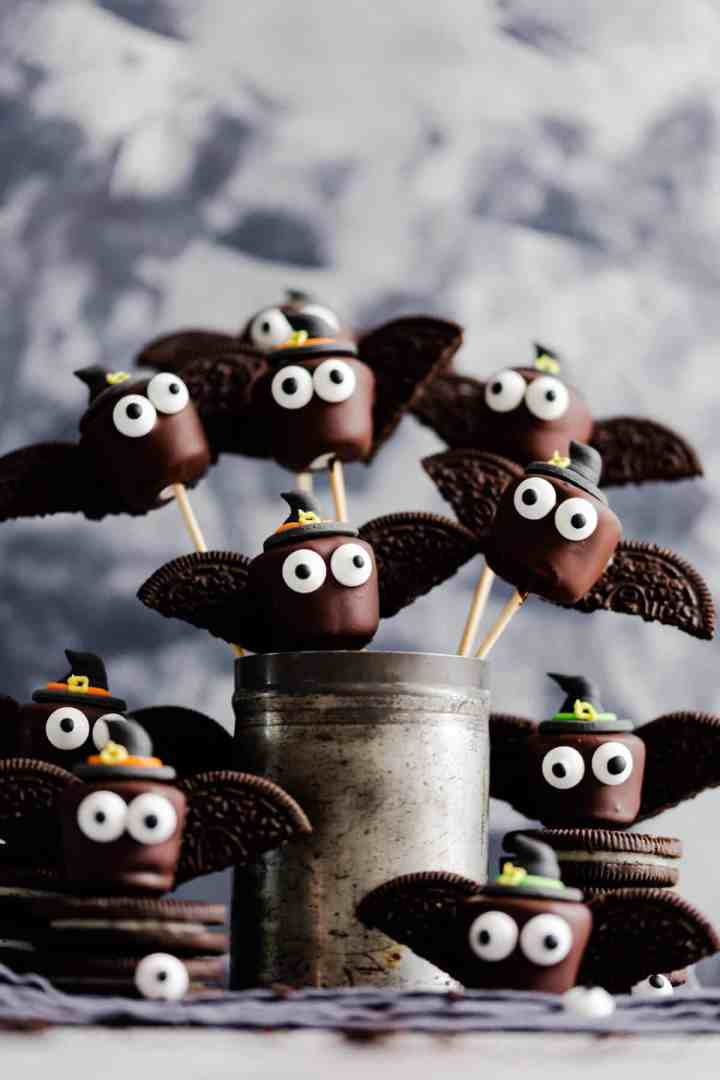 straight ahead shot at little chocolate marshmallow bats wearing witches hats
