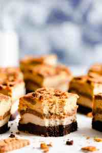 side close up of a pumpkin biscoff cheesecake brownie with bite taken out