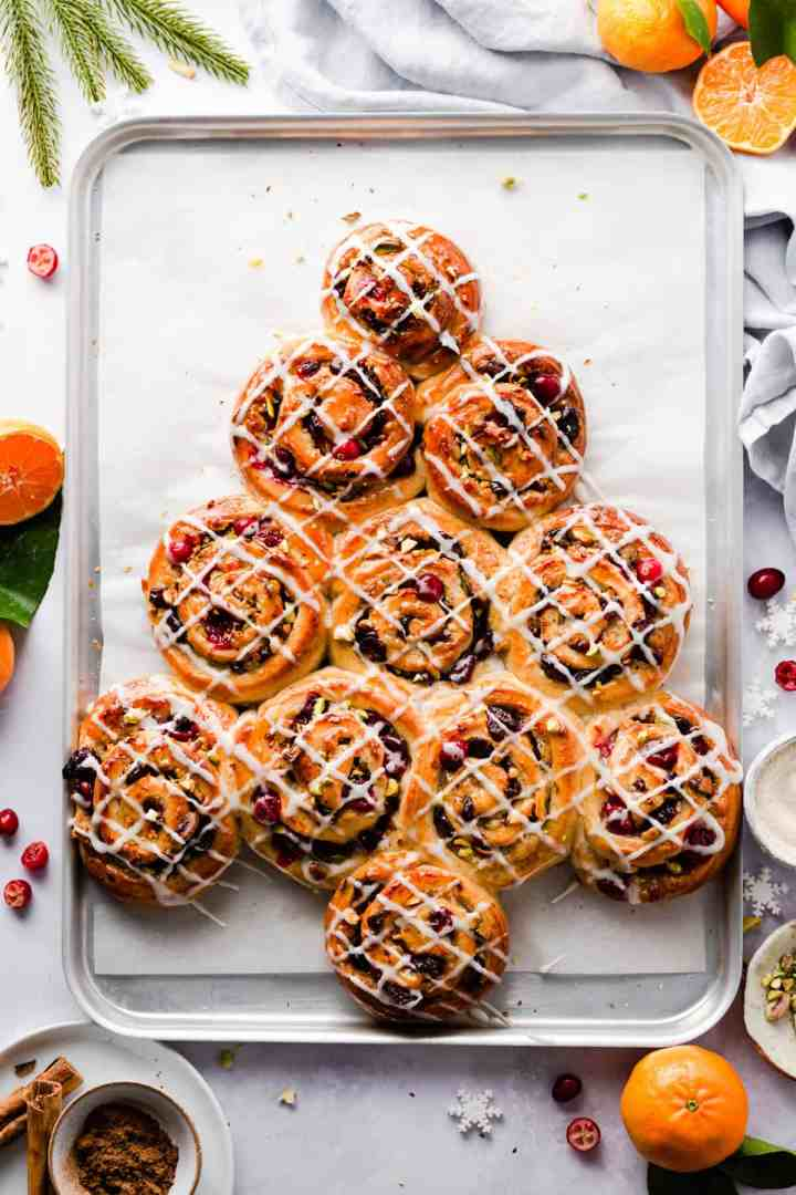overhead shot of buns shaped into a Christmas tree and drizzled with sugar glaze