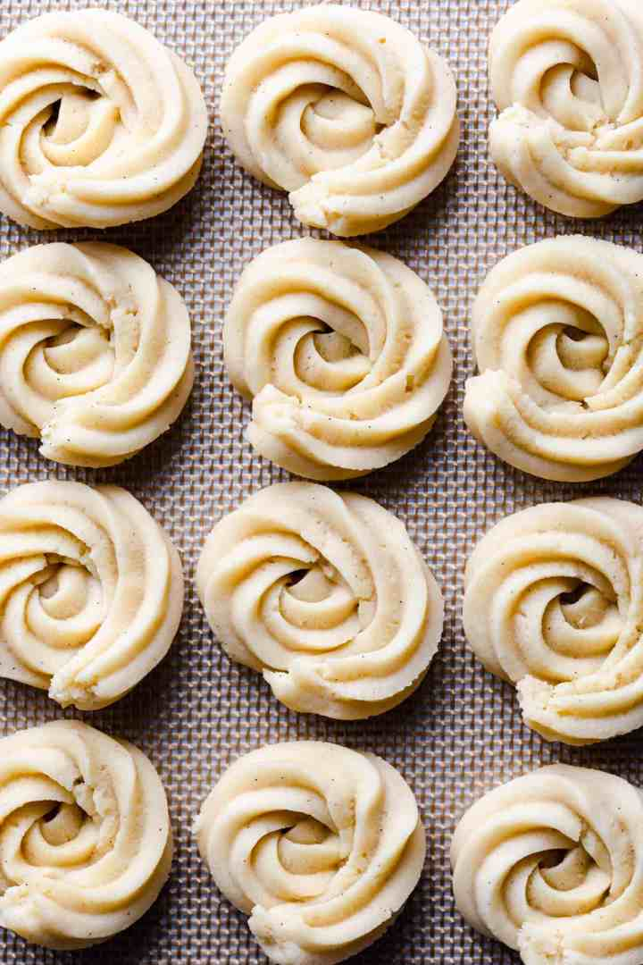 top view super close up at butter cookies shaped into swirls