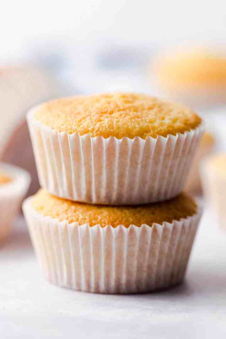 straight ahead super close up of one bowl vanilla cupcakes stacked on top of each other