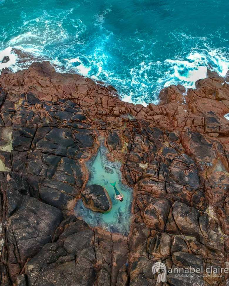 Mermaid in a rock pool taken from drone above