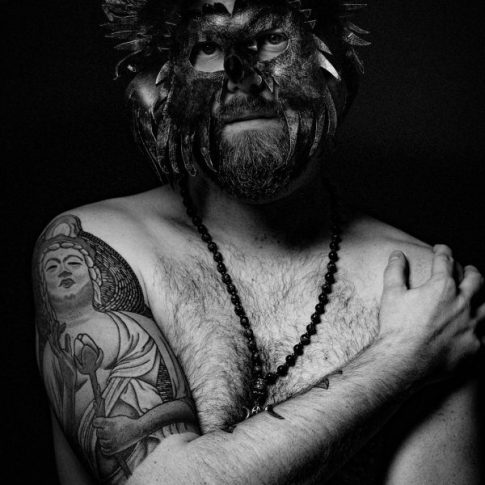fierce intimate vulnerable portrait session mask black and white man