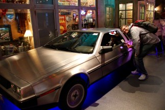 Ben with a DeLorean at the 'Classic Cars' exhibit at Venus Fort