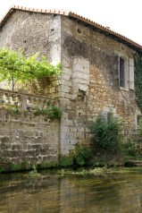 Brantome - the bit sticking out of the building was the old 'public bathroom' (which drained directly into the river)