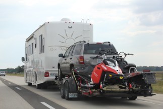 An RV hauling an SUV and TWO snowmobiles ... when we drove past we had second thoughts about our tiny BRZ