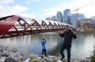 Tom and Ben goofing around in front of the Millennium Bridge in Calgary