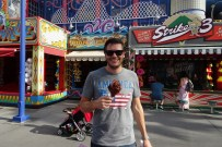Ben with a smoked turkey leg in the Simpsons section at Universal Studios Orlando, Florida