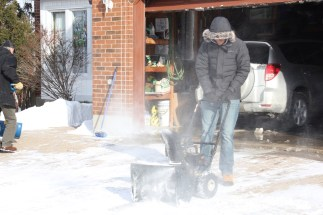 Ben trying out my Dad's snowblower on his Birthday