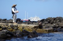 Our guide Leon trying to scare off a sea lion so we could land on Espanola Island, Galapagos