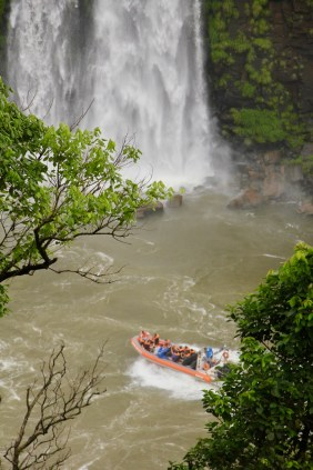 View of the speedboats that head under the waterfalls, Iguazu Falls, Brazil