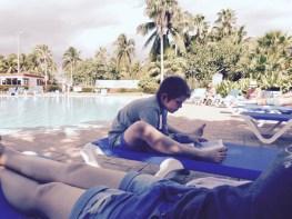 Gabriel doing homework by the pool in Varadero