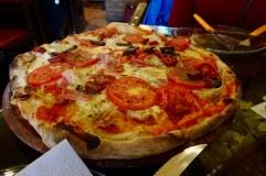 Italian style thin crust pizza in La Paz, Bolivia