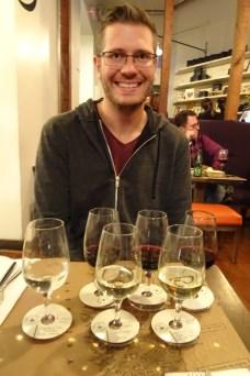 Ben with two wine flights at Bocanariz restaurant in Santiago, Chile
