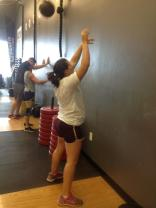The top of the wall ball exercise; medicine ball is thrown to a height of 10 feet. (Photo by Jessica Schroeder, CrossFit Sandstorm Coach)