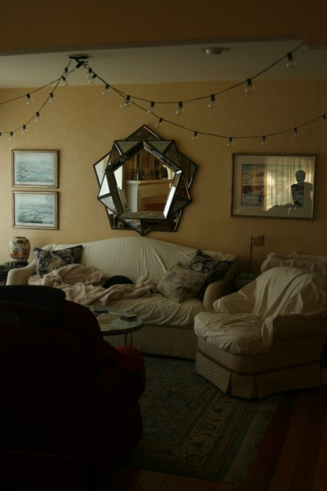 The adorable little living room spot in the house. the mirror thing over the couch ROCKS.