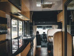 The interior of a motorhome shot toward the front