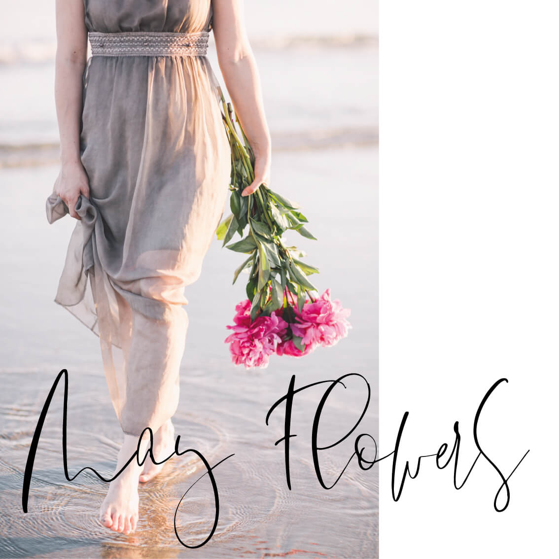 woman walking on the beach with a bunch of peonies