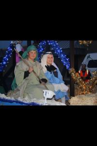 Christmas parade Isaac E and Mary