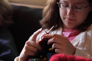 AnnaLeah knitting at cottage