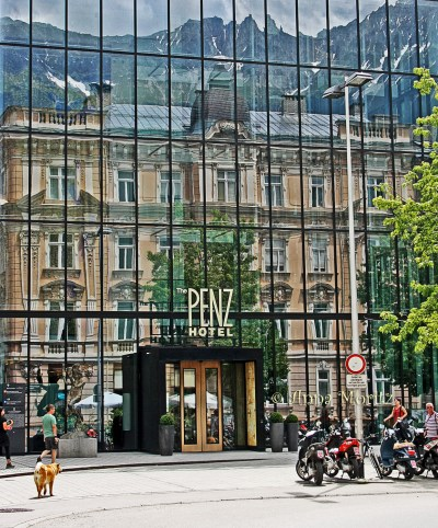 The Nordkette,reflecting in the glass facade of hotel Penz