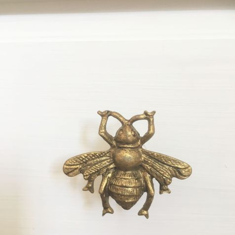 Gold bumble bee drawer knobs from Sass & Belle
