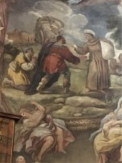 Church of St Anthony of Padua - fresco of St Anthony handing out alms