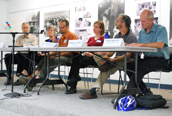 Panelists at the Sept. 23 Michigan Peaceworks forum on the local economy, from the left: Tom Weisskopf, University of Michigan economics professor; Ellen Clement, Corner Health Center executive director; Jeff McCabe, People's Food Co-Op board member; Lisa Dugdale, Transition Ann Arbor; Michael Appel, Avalon Housing executive director; John Hieftje, mayor of Ann Arbor.