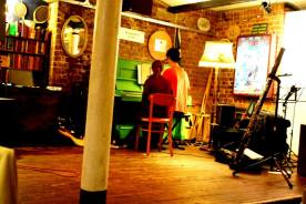 """Alfie Pugh performing """"Yearnings and Fears"""" on the Bike Shed's piano"""
