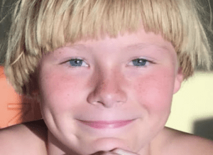 boy with blond bowl cut