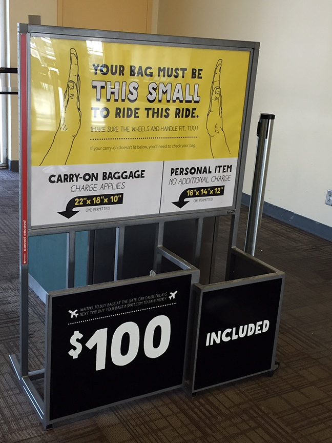 Spirit airlines sign  100 carry on bag policy. Thought you d avoid bag  charges by taking yours onboard  Man 68db3b15c0fa7