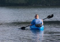 A guy in a kayak is nearby, having just launched.