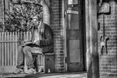 A husband stool outside a store.