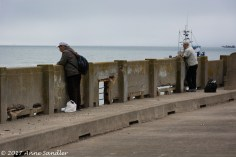 Some men, fishing I think, on the old pier.