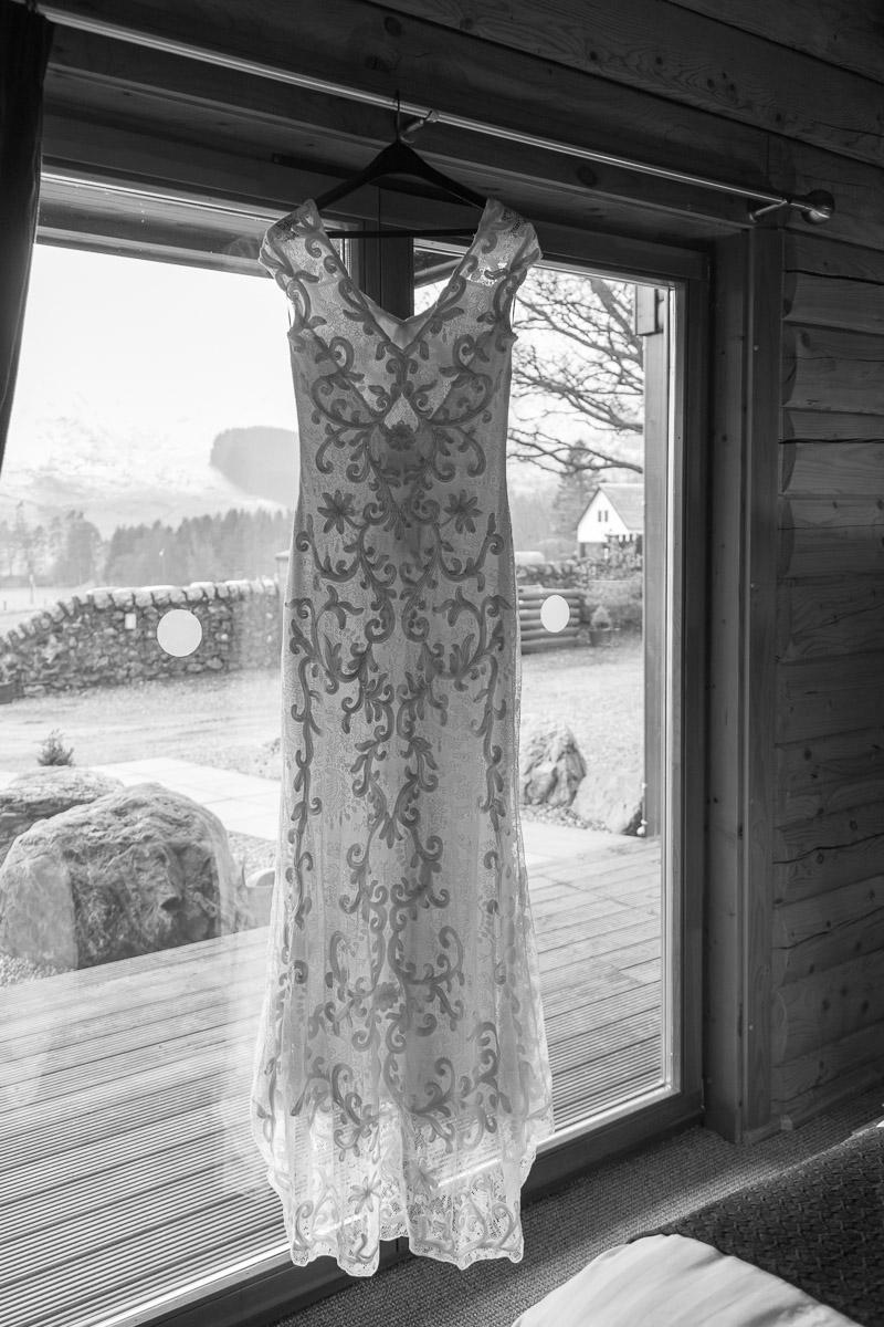 Wedding dress hanging by patio doors