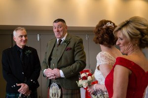 Groom looking towards his bride at Glen Clova Hotel
