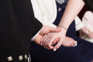 Bride and Groom holding hands at Forbes of Kingennie