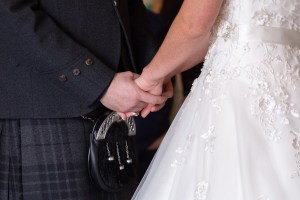 Bride and Groom holding hands at the Woodlands Hotel, Dundee