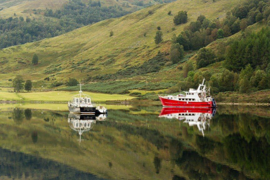 Boats reflecting on Loch Lochy