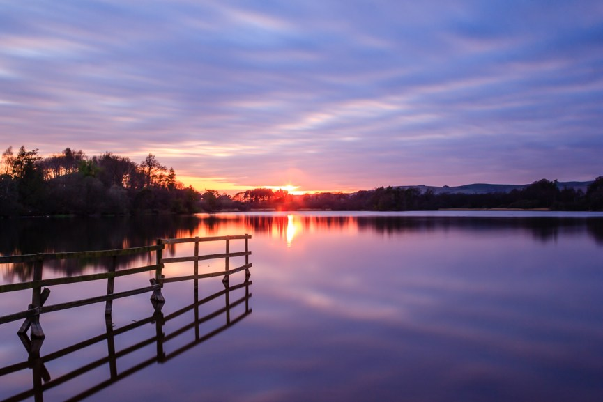 The sun sets over Balgavies Loch, Angus