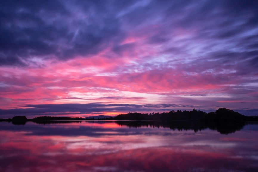 Dramatic skies reflecting on Monikie reservoir at sunset
