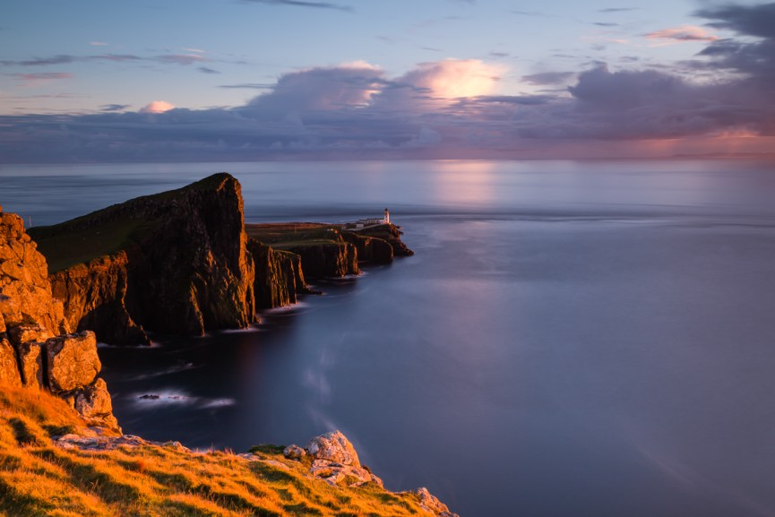The golden hour light shines on Neist Point as the sun sets