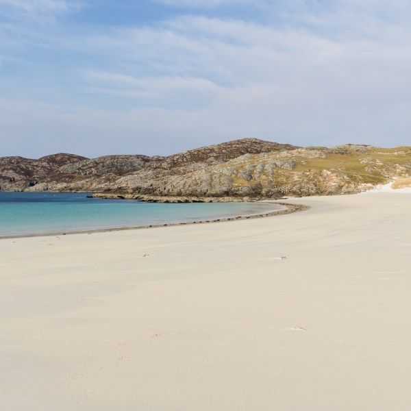 The white sands and blue sea of Achmelvich Bay