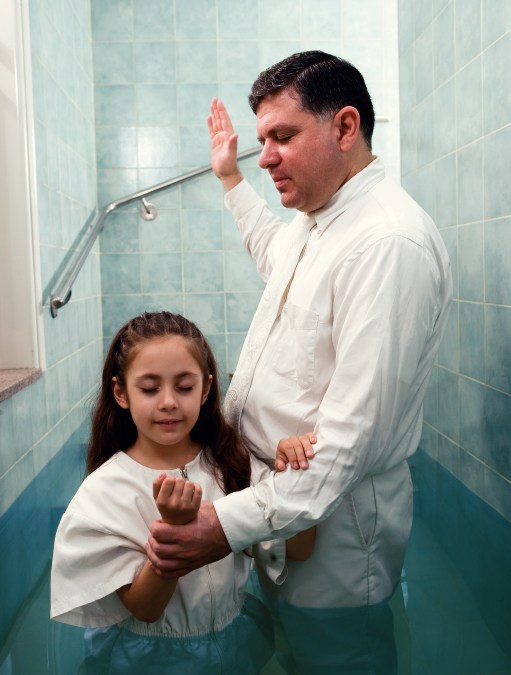 Young Girl being Baptized