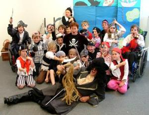 Grade 3 mini-pirates from Gidgegannup Primary School, WA, with the Flying Dutchman, WA children's author, Mike Lefroy, at the HeARTlines festival, June 2007. Photo Louise Schofield.
