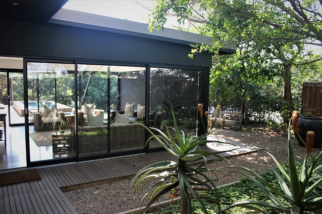 The Black Exterior of this Modern Home blends perfectly into the Environment