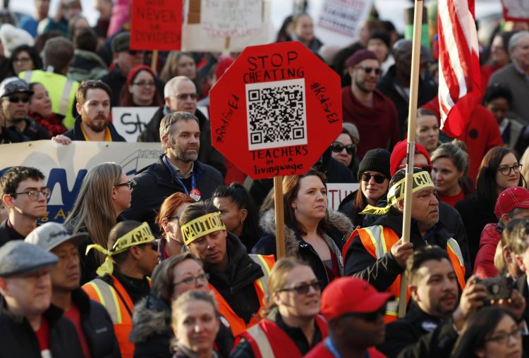 The  Latest:  Denver  instructors  go  on  strike  over  pay  conflict