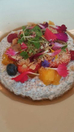 Coconut-set chia seeds, fresh Qld mango, strawberries, blueberries, coconut, maple, macadamia & local rose petals