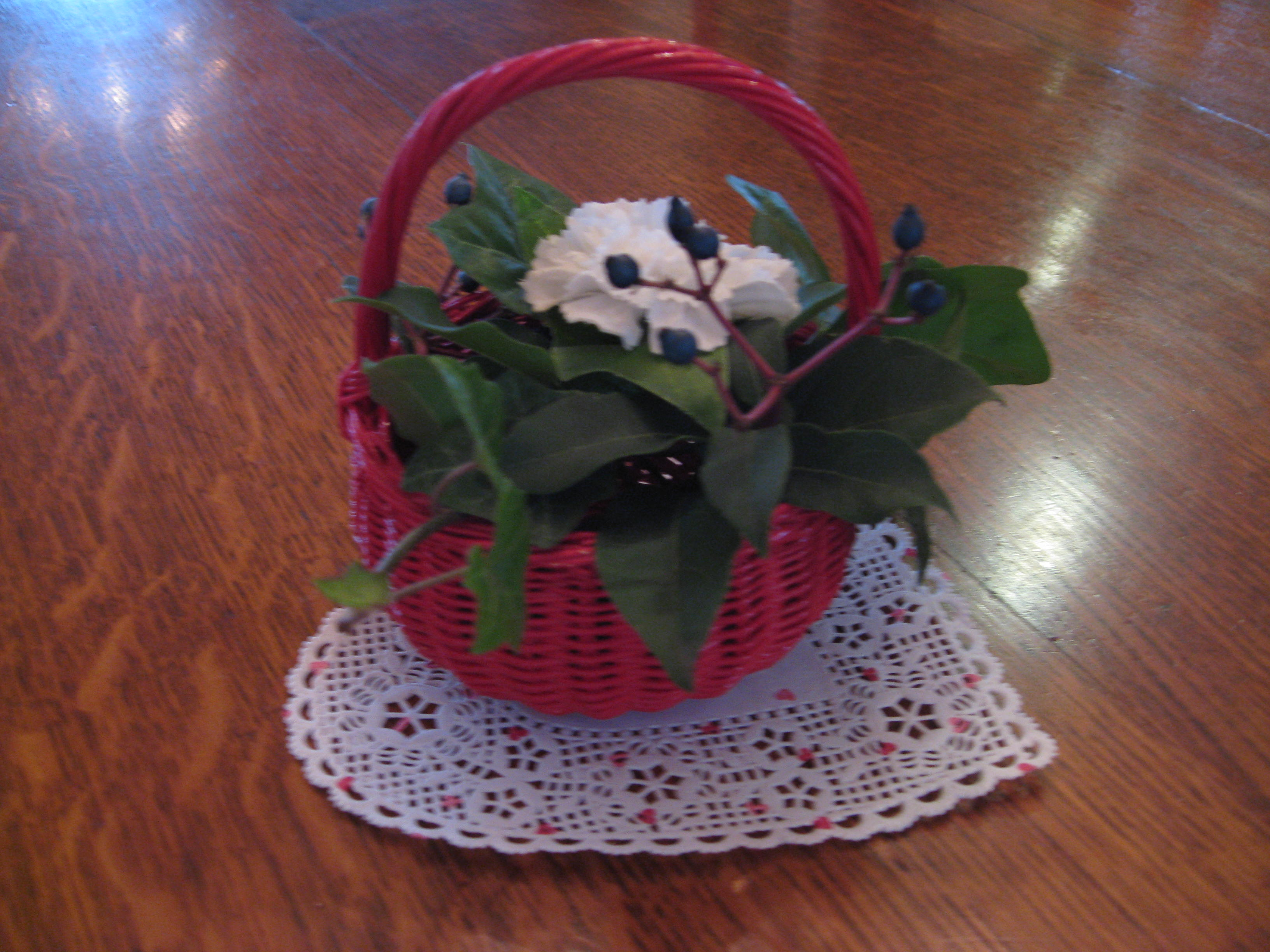 Small red basket with ivy and carnations