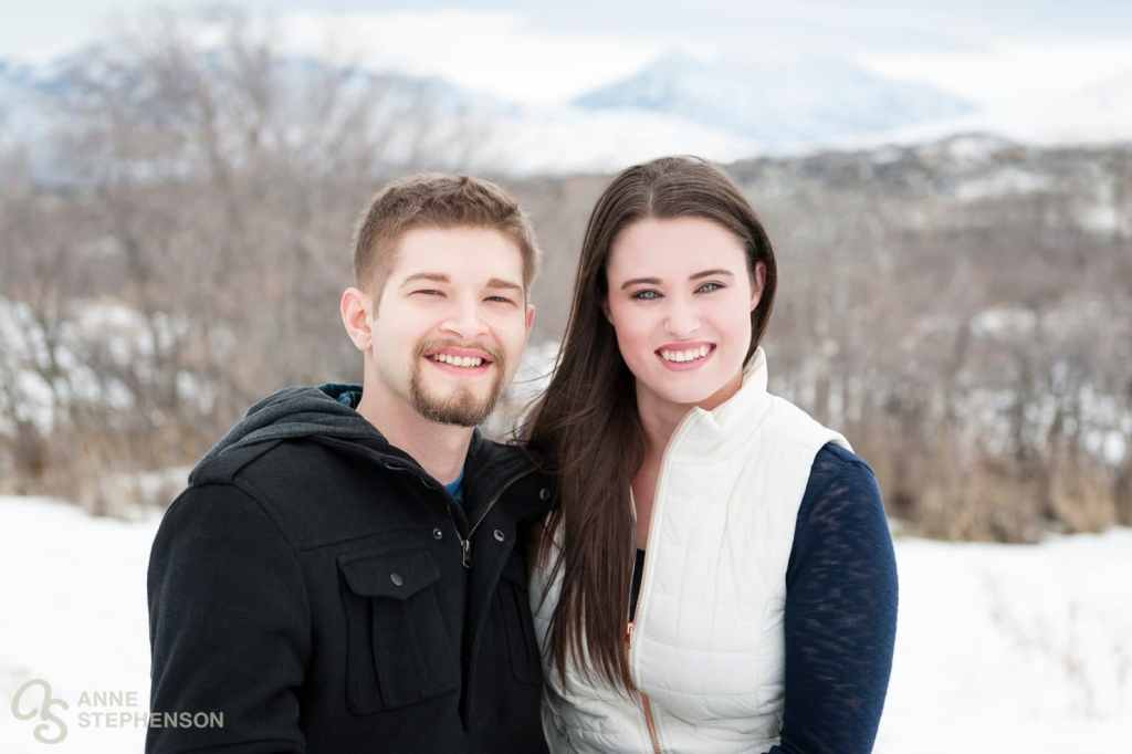 Between the bursts of wind, we captured this more traditional camera-facing photo. I love how the stormy mountains appear in the background and give some additional blue color to the scene. (Stacie's colors are navy, cream and blush).